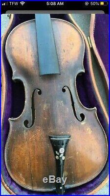 Old vintage antique violin in alligator style leather case
