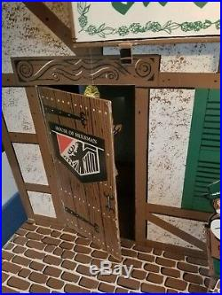(VTG) 1960s old style beer swiss chalet house motion moving advertising sign wi